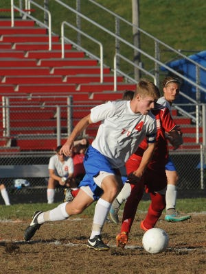 Zane Trace's Darby Pillow drives the ball downfield during a regular season game against Fairfield in 2015.