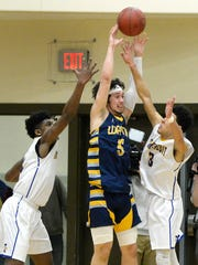 Wayne's Braeden Zenelovic, center, is defended by Irondequoit's Robert Diaz-Judson, right, and Gerald Drumgoole during the Class A regional qualifier played at Rush-Henrietta High School, Wednesday, March. 7, 2018.