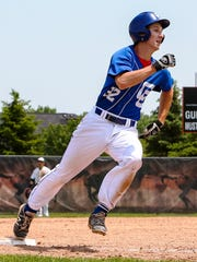 Catholic Central's Nick Sykes makes the turn around third.