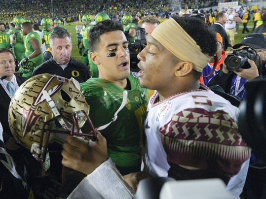 In this Jan. 1, 2015, file photo, Oregon quarterback Marcus Mariota, center left, greets Florida State quarterback Jameis Winston after Oregon's win in the Rose Bowl. The spotlight for today's NFL openers will find its way to the Buccaneers and Titans, who were a combined 4-28 last season. The reason? Mariota and Winston will be under center.