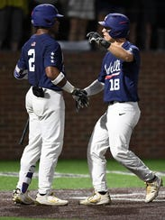 Vanderbilt left fielder Pat DeMarco (18) is congratulated