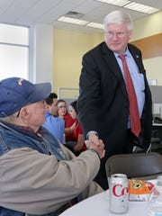 U.S. Rep. Glenn Grothman, right, shakes the hand of Gene Smith during a special Veterans Day program Friday, Nov. 11, 2016, at Russ Darrow VW/Nissan in Sheboygan.  Grothman recently shared his thoughts on President Trump and other White House topics.