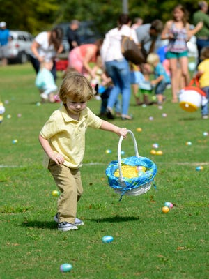 Kids race to pick up Easter eggs Saturday during the city of Pensacola Parks and Recreation Department's Easter Egg Hunt at Roger Scott Athletic Complex,