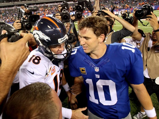 "Peyton Manning (18) improved to 3-0 in the ""Manning Bowl"" as his Broncos thumped little brother Eli's Giants 41-23 at MetLife Stadium in East Rutherford, N.J., on Sept. 15, 2013."