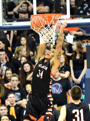 Jarron Cumberland finds the land of slam for Wilmington as the Hurricane play in the Region Final at the Cintas Center, March 12. Wilmington could be moving to a new league.