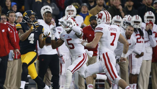 Iowa's Tevaun Smith (4) had a game-high 78 receiving yards on four receptions in the Hawkeyes' loss to Wisconsin.