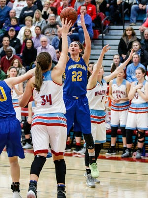 Mukwonago sophomore Angie Cera (22) elevates for a shot during the game at Arrowhead on Friday, Jan. 5.