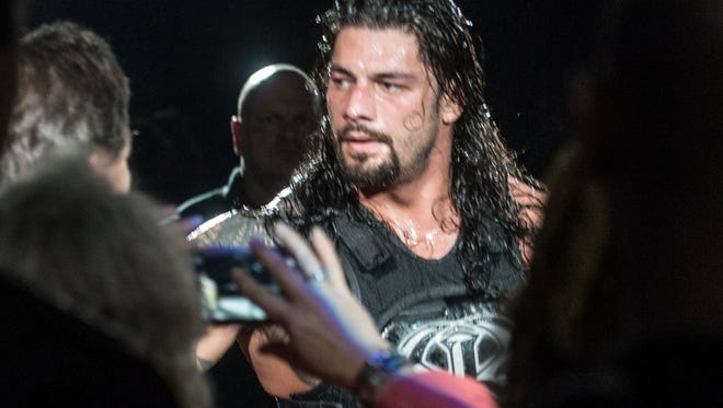 WWE champion Roman Reigns greets fans after his match. The stars of the WWE slammed into Garrett Coliseum in Montgomery, Ala., on Saturday, Jan. 9, 2016.