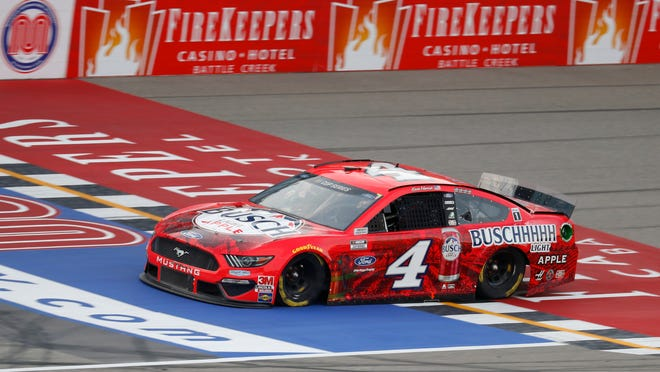 Kevin Harvick crosses the finish line during a NASCAR Cup Series auto race at Michigan International Speedway in Brooklyn, Mich., Saturday, Aug. 8, 2020.