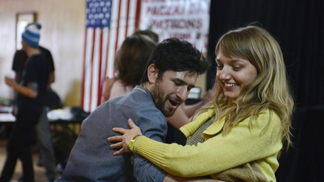 Sam Newman, 28, of Detroit, dances with Jennie Knaggs, 37, of Detroit at a Detroit Square Dance Society dance at Hamtramck's P.L.A.V. 10 Hall during the Hamtramck Music Festival on March 6.
