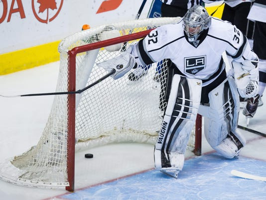 Los Angeles Kings' goalie Jonathan Quick breaks Vancouver Canucks' defenceman Dan Hamhuis' stick on the goal post after he was slashed during the third period of an NHL hockey game in Vancouver, British Columbia, Monday, April 4, 2016. (Darryl Dyck/The Canadian Press via AP) MANDATORY CREDIT
