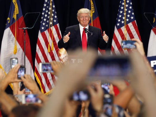 Republican presidential candidate Donald Trump delivers