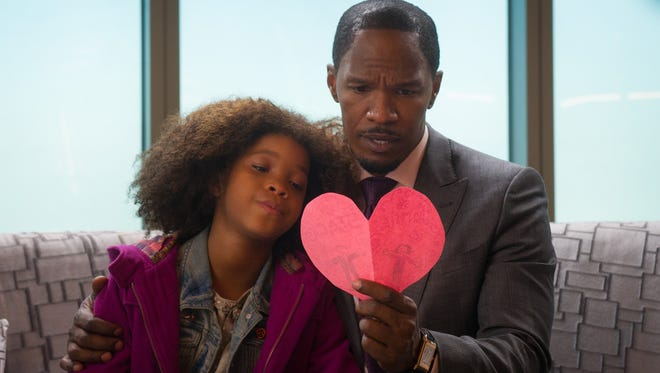 Quvenzhane Wllis and Jamie Foxx in a scene from the motion picture 'Annie.'