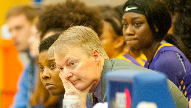 Male head basketball coach Champ Ligon, Jr. watches his team's play during the final minute of the Seventh Region girls basketball semifinals. Thursday, March 1, 2018