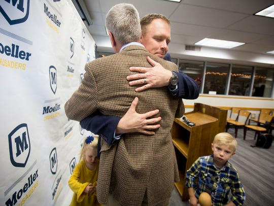 Mon., Dec. 4, 2017: Doug Rosfeld (facing) gets a hug