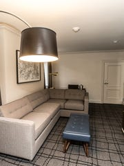 The suites at Le Meridien Hotel feature sitting areas, modern floor lamps, and TVs in the bathroom mirrors. The hotel is located at 123 S. Illinois St., in Indianapolis.