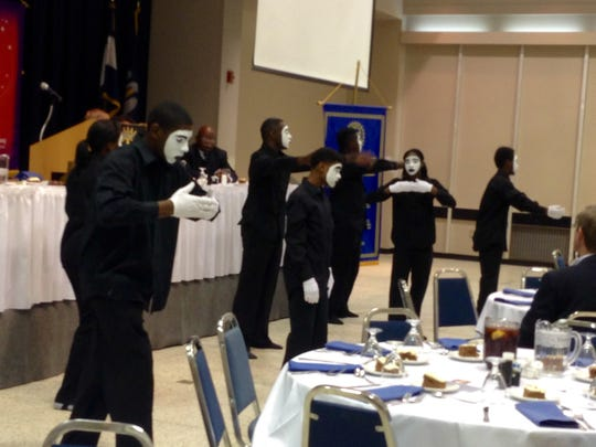 Praise dancers with Christian Love Baptist Church perform for the Rotary Club of Alexandria on Tuesday.