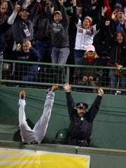 In this Oct. 13, 2013 photo, fans and Boston Police