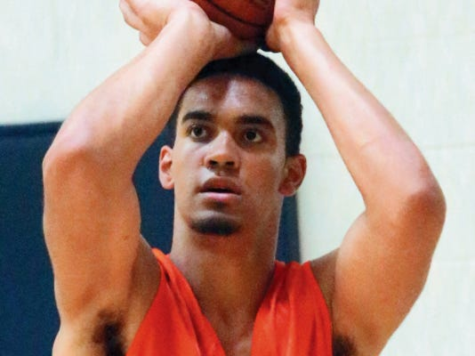 """Rudy Gutierrez—El Paso Times 17-year-old Christian Romine, 6' 9"""",  220 pounds, was introduced as a member of the UTEP basketball team Tuesday."""