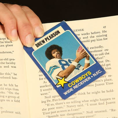 Becky Willhite holds a trading card of former Cowboys