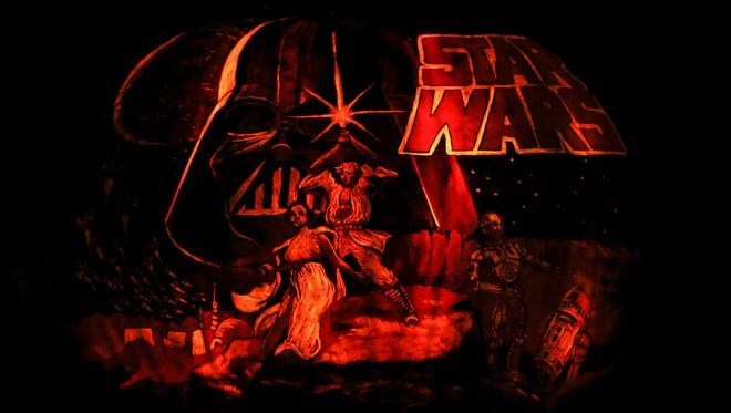 A pumpkin carved with the likeness of the original Star Wars movie poster at the Jack-O-Lantern Spectacular.Oct. 8, 2015