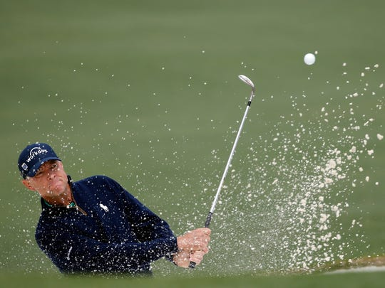 Davis Love III chips out of a bunker on the second hole during the final round of the Masters golf tournament Sunday, April 10, 2016, in Augusta, Ga. (AP Photo/Matt Slocum)