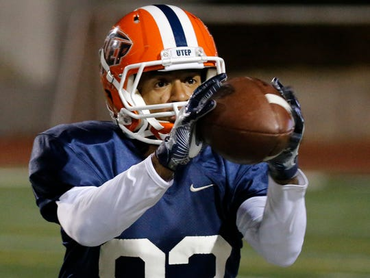 UTEP wide receiver Tre'Shon Wolf pulls in the football