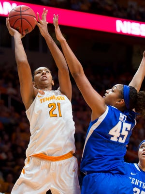 Tennessee's Mercedes Russell (21) attempts a shot past Kentucky's Alyssa Rice (45) during the first half against Kentucky at Thompson-Boling Arena on Sunday, Jan. 1, 2017.