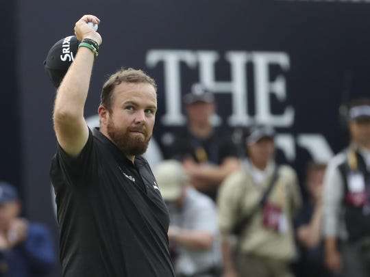 Ireland's Shane Lowry reacts to the crowd on the 18th green during the third round of the British Open Golf Championships Saturday at Royal Portrush in Northern Ireland