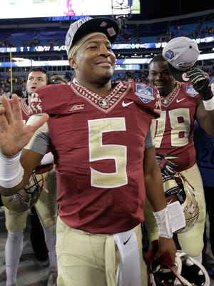 Florida State quarterback Jameis Winston (5) celebrates after winning the Atlantic Coast Conference championship NCAA college football game against Georgia Tech in Charlotte, N.C., Saturday, Dec. 6, 2014. Florida State won 37-35. (AP Photo/Chuck Burton)