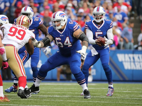 Bills Richie Incognito drops to pass block for quarterback Tyrod Taylor.