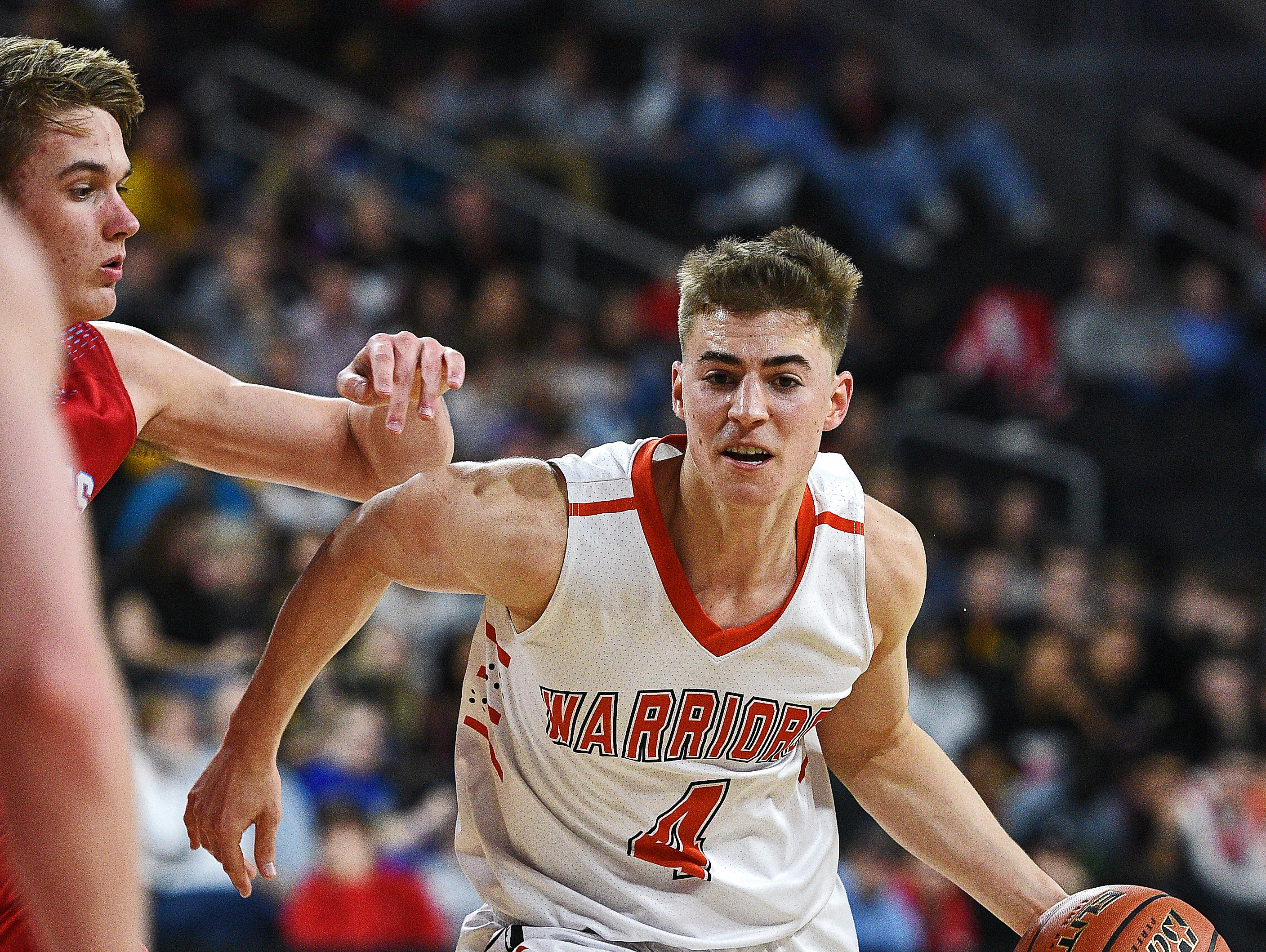 Washington's Sam Siganos (4) drives with the ball during the South Dakota Class AA State Boys Basketball Tournament championship game against Lincoln Saturday, March 19, 2016, at the Denny Sanford Premier Center in Sioux Falls. Lincoln beat Washington 53 to 48.