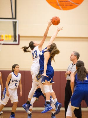 Odem's Julisa Alcala (23) and San Diego's Laura Canales (55) leap on the opening tip of a Region IV-3A quarterfinal at the Tuloso-Midway High School on Tuesday February 21, 2017.