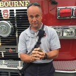 Lt. Dominick Landolfi holding one of the starlings his unit rescued on Tuesday. Art provided by Rene Smith, the Brevard County resident who alerted firefighters to the plight of the trapped baby birds.