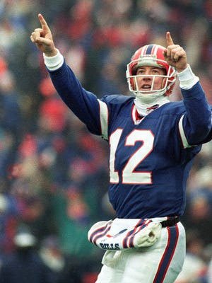 FILE - In this Sunday, Jan. 23, 1994, file photo, Buffalo Bills quarterback Jim Kelly reacts to the Bills' last touchdown in the fourth quarter during the AFC Championship game at Rich Stadium in Orchard Park, N.Y. It's been 23 years since the Bills made and lost its fourth consecutive Super Bowl appearance. Kelly will be in York County on Friday, Oct. 13 as the keynote speaker at a YMCA black tie gala fundraiser.