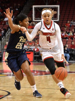 Louisville's Mariya Moore (4) drives past the defense of Pittsburgh's Destinie Gibbs (22) during the first half of their NCAA college basketball game, Sunday, Jan. 08, 2017 in Louisville Ky. Louisville won 73-52.