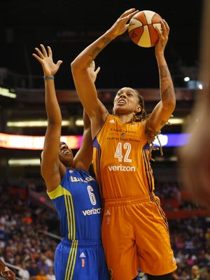 Phoenix Mercury center Brittney Griner (42) shoots while defended by Dallas Wings forward Kayla Thornton (6) during the first quarter at Talking Stick Resort Arena in Phoenix, Ariz. May 14, 2017.