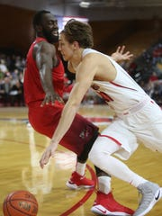 Marist College's Ryan Funk drives past a Fairfield