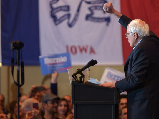 Sen. Bernie Sanders gives a fist pump to a crowd in