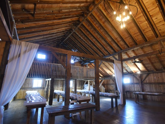 An old barn serves as a venue for weddings,reunions