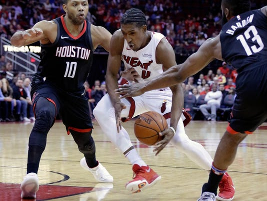 Miami Heat forward Josh Richardson (0) has the ball knocked away between Houston Rockets guards Eric Gordon (10) and James Harden (13) during the first half of an NBA basketball game Monday, Jan. 22, 2018, in Houston. (AP Photo/Michael Wyke)