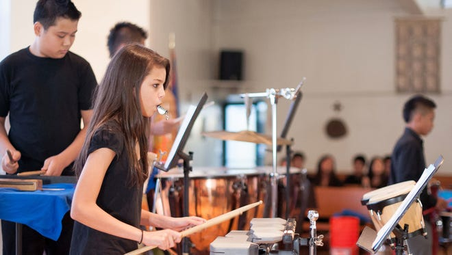 In this March 3, 2012, file photo, Shelby Weilbacher performs alongside fellow members of the Piti school?s percussion band at St. John?s Episcopal Church as part of the Tumon Bay Music Festival.