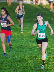 Fort Myers High School's Kristlin Gear, right, competes