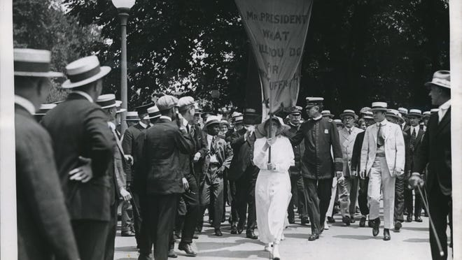 Suffragettes march in March, 1917, during President Woodrow Wilson's second inaugural parade. With passage of the 19th amendment three years later, women were allowed to vote in the United States.