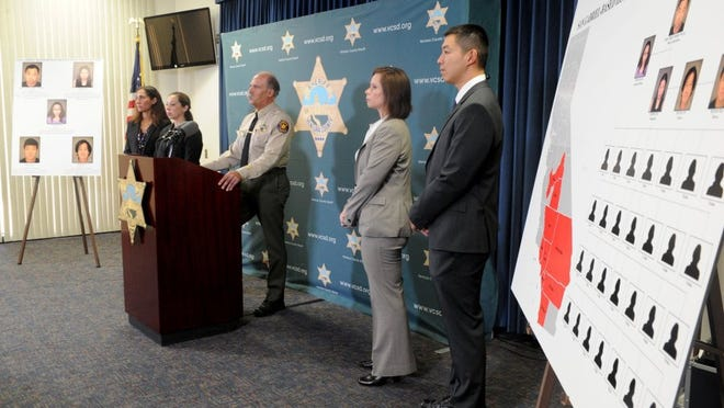 During an Aug. 23 news conference, Undersheriff Gary Pentis (center) talks about the arrests of five people on suspicion of operating a human trafficking ring. One of the people arrested entered a not guilty plea Wednesday.