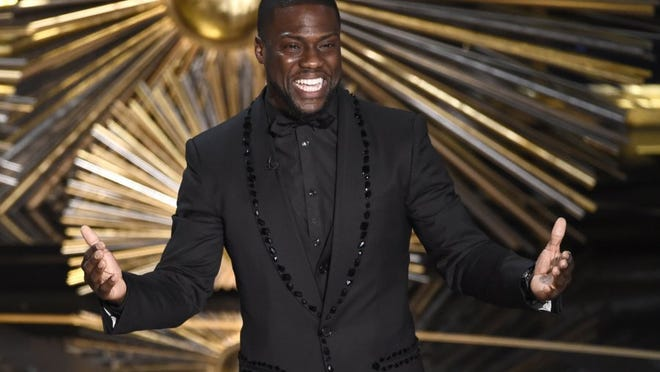 Associated Press file Kevin Hart speaks at the Oscars at the Dolby Theatre in Los Angeles in this file photograph. Hart's latest stand-up film is 'What Now?'