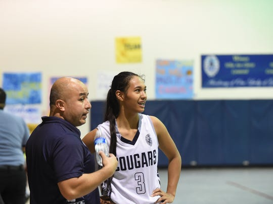 Academy of Our Lady of Guam head coach Eddie Pelkey, left, guided the Cougars to an undefeated regular season, even with star senior Kali Benavente injured for more than 1/4 of their games.