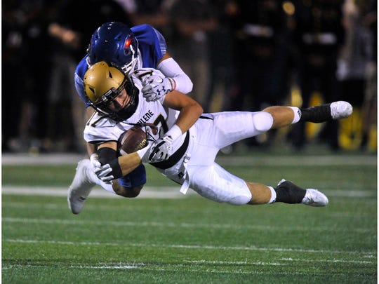 Abilene High School wide receiver Wes Berry is tackled by Cooper High School's A.J. Gonzales during Friday's crosstown showdown Sept. 15, 2017. Cooper won, 49-35.