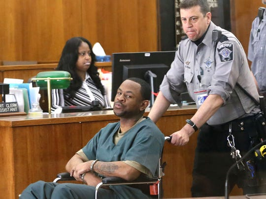 Antonio Smith is wheeled into Milwaukee County Circuit Court, where he asked to have his earlier guilty plea withdrawn. Smith is charged in two homicides as part of a witness intimidation case.