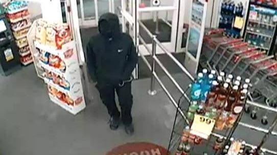 Investigators release images of man suspected in Sept. 22 and 28 robberies; person of interest also sought